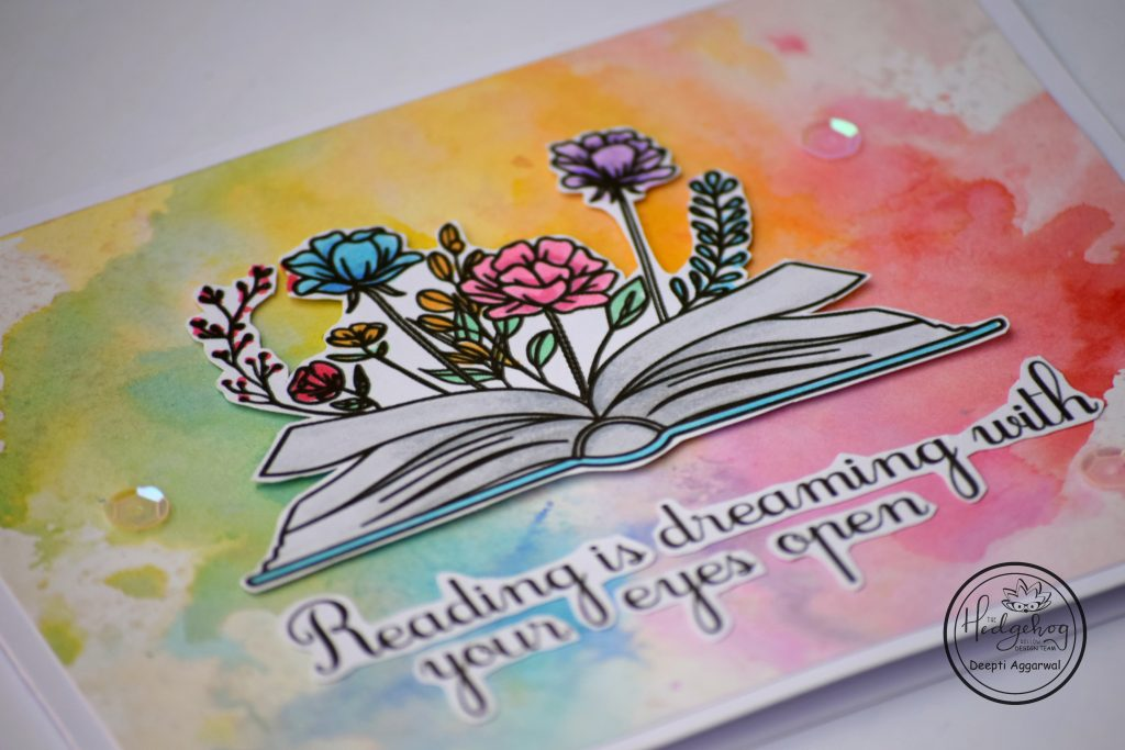 Rainbow card with open book with flowers