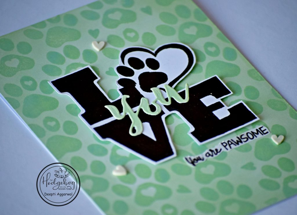 Close up of Paw print stamped Love card